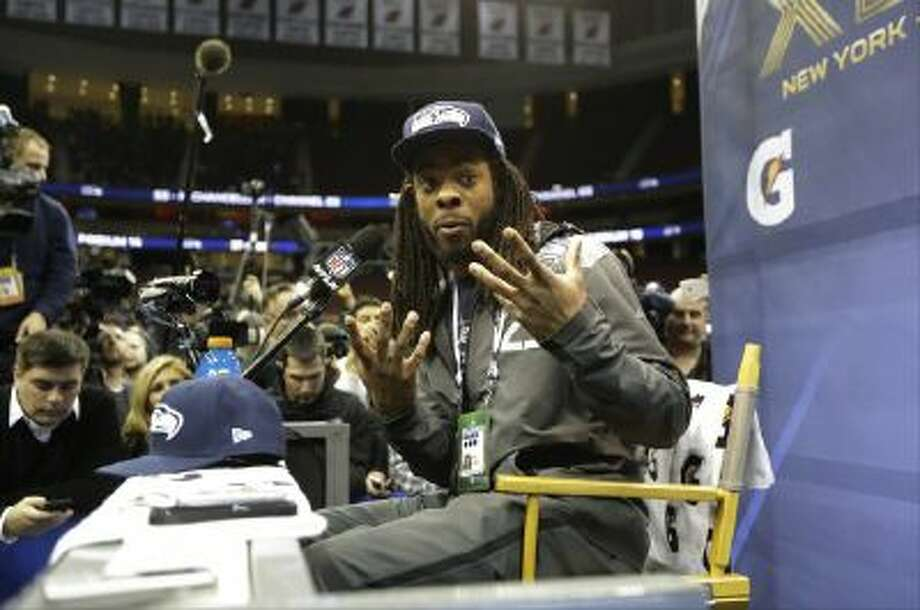 Seattle Seahawks' Richard Sherman answers a question during Media Day.