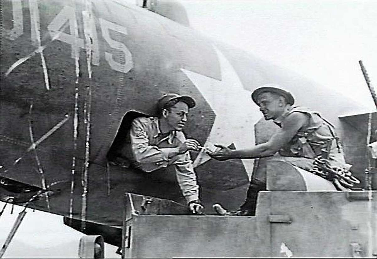 An Australian soldier fraternizes with a crewman of an American B26 bomber in 1942. Australians and Americans fought side by side in the Pacific.