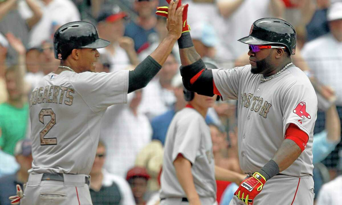 Boston Red Sox first baseman David Ortiz (34) celebrates with Xander Bogaerts (2) after hitting a two-run homer during the fifth inning of Monday's 8-6 win over the Braves in Atlanta.