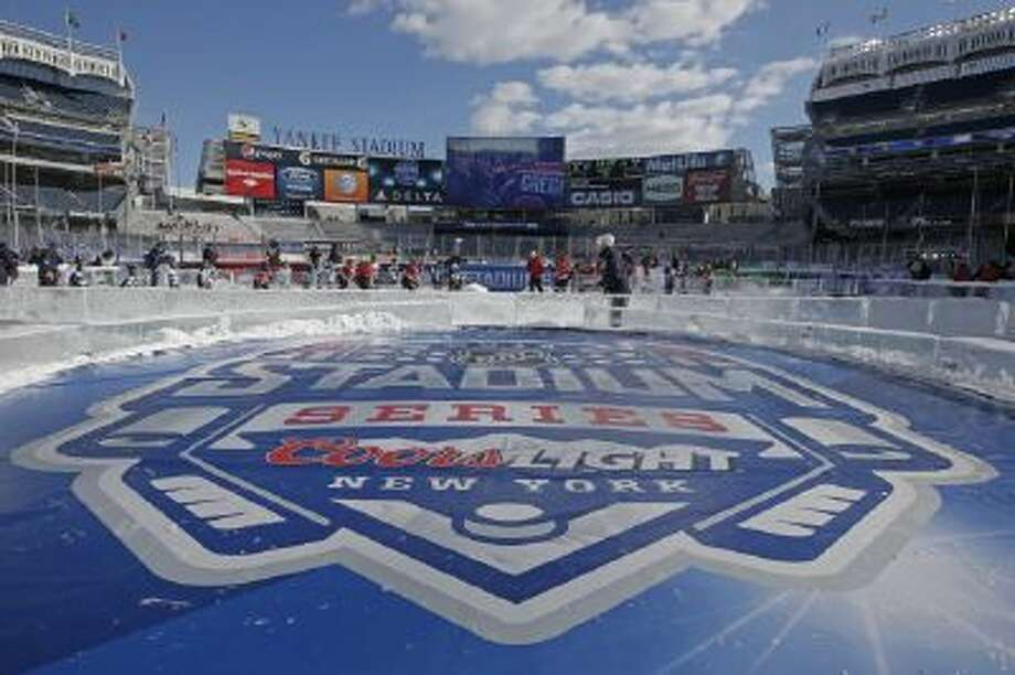 Yankee Stadium hosted an outdoor game between the Devils and Rangers.