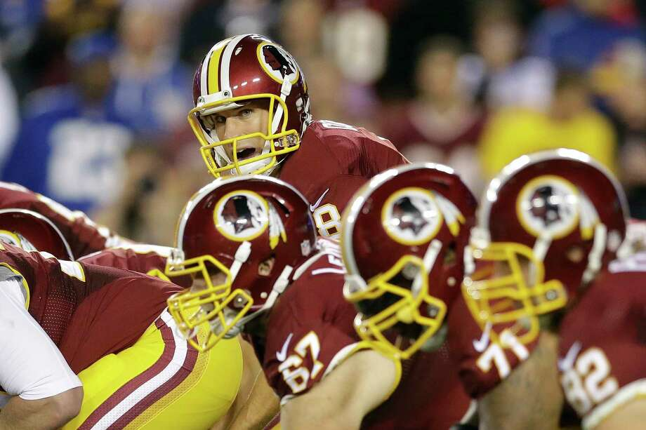 Washington quarterback Kirk Cousins (8) looks down the line during the first half Thursday. Photo: The Associated Press  / AP