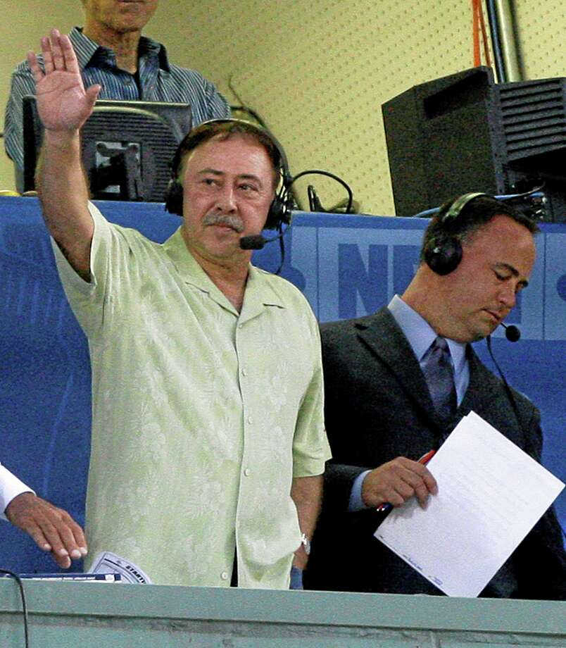 Red Sox announcer Jerry Remy waves to the crowd from the television broadcast booth at Fenway Park during a game against the Tigers in Boston. Photo: The Associated Press File Photo  / AP
