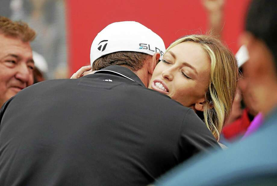 Golfer Dustin Johnson and fiancée Paulina Gretzky announced they are expecting a child. Photo: Eugene Hoshiko — The Associated Press File Photo  / AP2013