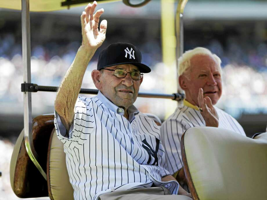 Hall of Famer catcher Yogi Berra, left, and pitcher Whitey Ford ride in the shade of a golf cart before the New York Yankees 67th annual Old Timers Day baseball game Sunday, June 23, 2013, in New York. Photo: AP Photo/Kathy Willens  / AP