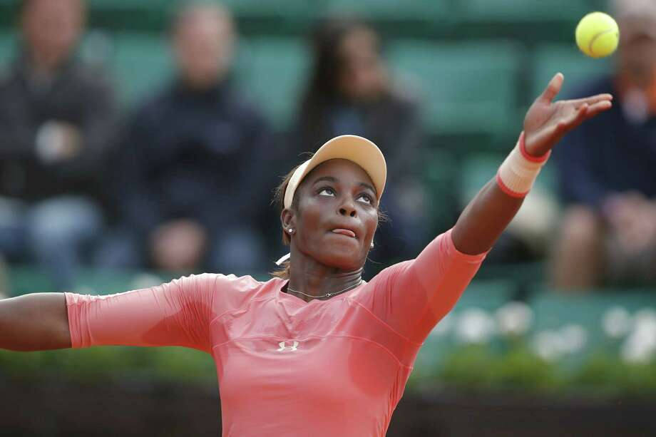 Sloane Stephens serves in a first-round match at the French Open against Venus Williams on Monday at the Roland Garros stadium in Paris. Photo: Michel Euler — The Associated Press  / AP