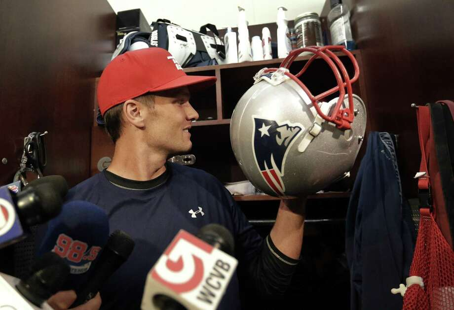 New England Patriots quarterback Tom Brady speaks with reporters in the locker room at Gillette Stadium before practice on Wednesday. Photo: Steven Senne — The Associated Press  / AP