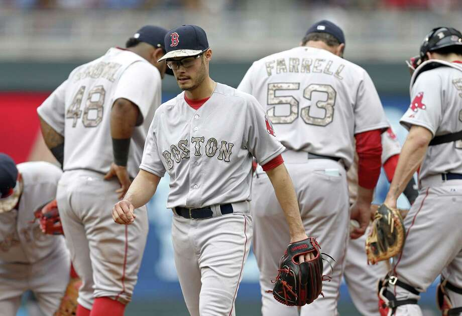 Boston Red Sox pitcher Joe Kelly leaves in the second inning of Monday's game after giving up seven runs to the Minnesota Twins in Minneapolis. Photo: Jim Mone — The Associated Press  / AP