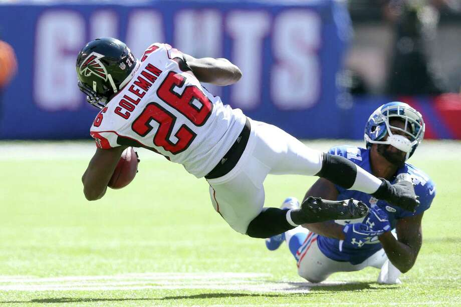 New York Giants cornerback Dominique Rodgers-Cromartie suffered a concussion on this tackle of Atlanta Falcons running back Tevin Coleman on Sunday in East Rutherford, N.J. Photo: Brad Penner — The Associated Press  / FR171375 AP