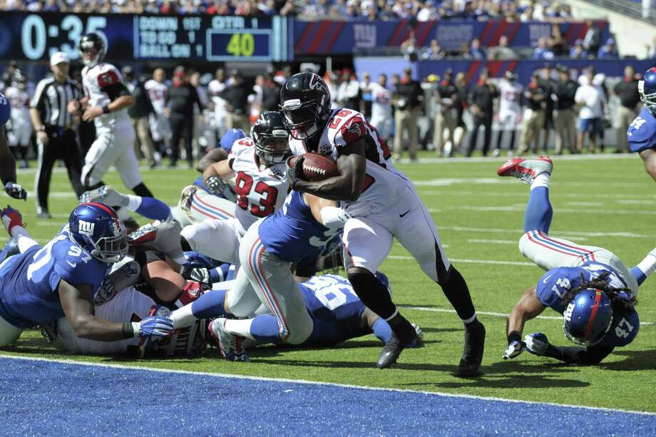 Atlanta Falcons running back Tevin Coleman scores a touchdown against the New York Giants on Sunday in East Rutherford, N.J. Photo: Bill Kostroun — The Associated Press  / FR51951 AP