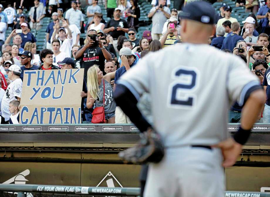 Yankees fans hold a sign for Derek Jeter after the Yankees defeated the White Sox 7-1 on Sunday. Photo: Nam Y. Huh — The Associated Press  / AP
