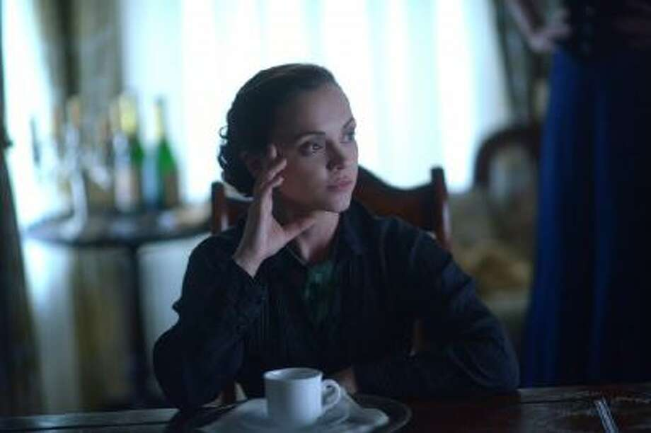 """Christina Ricci stars in Lifetime's made-for-TV movie """"Lizzie Borden Took an Ax"""" as the infamous woman charged with ax-murdering her parents in 1892."""