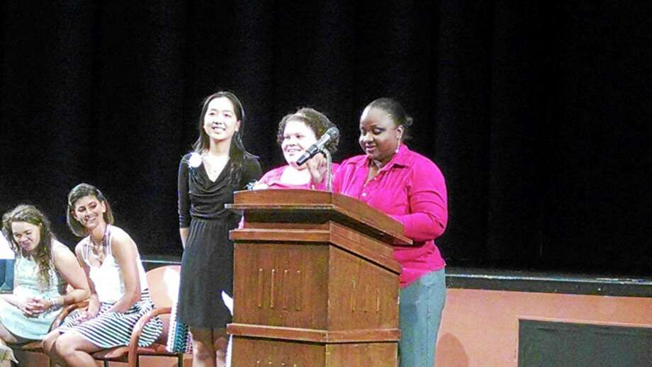 Middletown High School chemistry teacher Roberta Downer presents an Honors Award to Brittany Leary and Lily Zhao. Photo: Courtesy Of Middletown High School