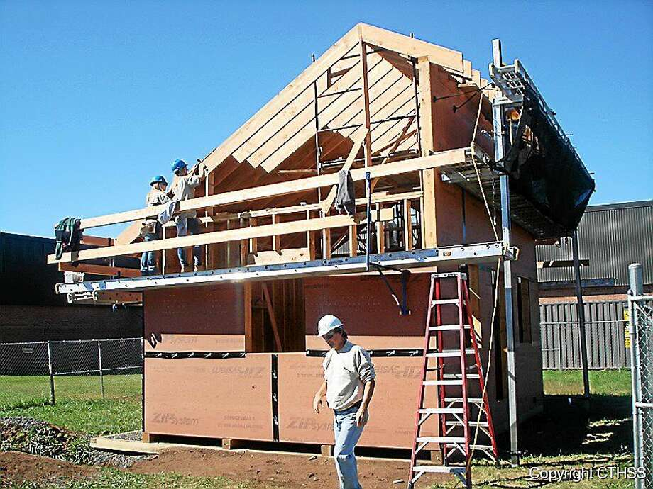 Connecticut Technical High Schools students are working with the latest green construction technologies in building E-houses at seven of 17 locations in state, including one at Vinal Technical High. Photo: Courtesy Photo