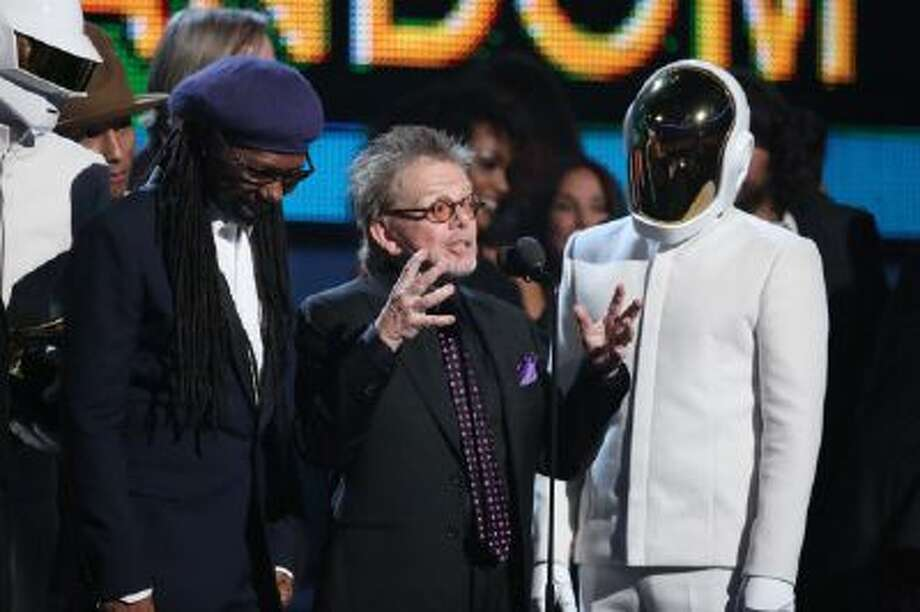 "Nile Rodgers, left, Paul Williams and Guy-Manuel de Homem-Christo of Daft Punk accept the award for album of the year for ""Random Access Memories"" at the 56th annual Grammy Awards at Staples Center on Sunday, Jan. 26, 2014, in Los Angeles."