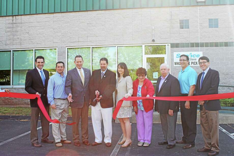 From left are Chamber VP Jeff Pugliese, Safelite District Manager Jamie Donais, state Sen. Paul Doyle, Cromwell Mayor Enzo Faienza, state Rep. Christie Carpino, Cromwell PZ Commissioner Alice Kelly, Councilmen Alan Spots and Frank Emanuele, Town Planner Stuart Popper. Photo: Submitted Photo