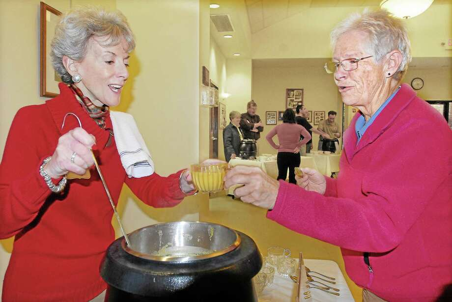 Cynthia Clegg, president and CEO of the the Community Foundation of Middlesex County serves up a cup of Curried Apple Pumpkin soup made by the Ladies of Faith Lutheran Church at the annual Amazing Challenge in this file photo. Photo: Catherine Avalone/The Middletown Press