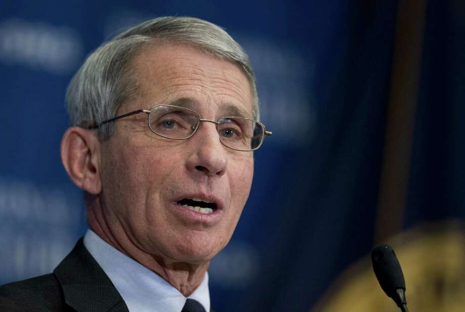 FILE - In this Nov. 21, 2014, file photo, National Institute of Allergy and Infectious Diseases (NIAID) Director Anthony Fauci speaks about the Ebola outbreak during a National Press Club luncheon in Washington.  U.S. officials say a long-awaited major study of possible Ebola vaccines is set to begin in Liberia within a couple of weeks. New infections are falling, but Fauci says it's not too late for the vaccine study. Clusters of cases continue, and he says some participants would undergo special testing to see how their immune systems respond to the vaccine. (AP Photo/Manuel Balce Ceneta, File) Photo: AP / AP