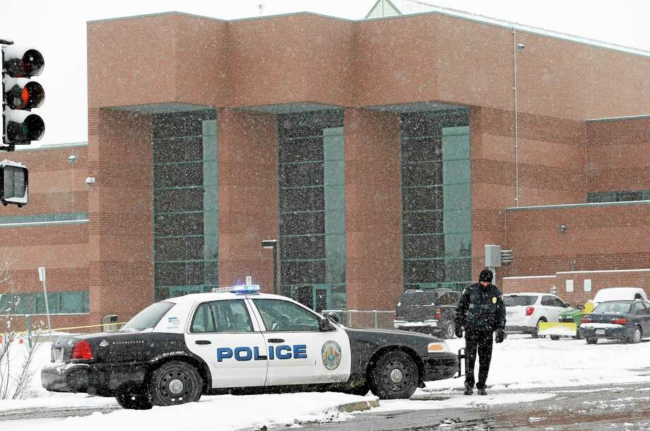 A police cruiser blocks the entrance to Standley Lake HIgh School, where classes were cancelled after an apparent suicide attempt by a student, in Westminster, Colo., Monday, Jan. 27, 2014. Police say a 16-year-old boy was critically injured after setting himself on fire at the suburban Denver high school. (AP Photo/Brennan Linsley) Photo: AP / AP
