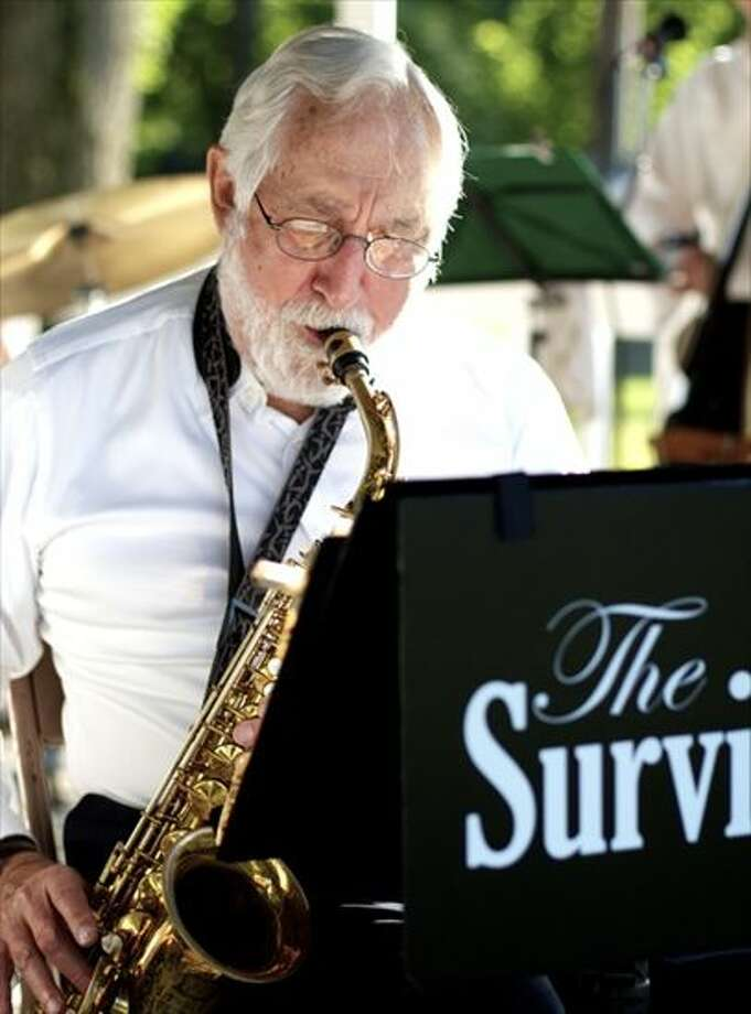 Jules Bashkin on alto sax,, of the Survivors Swing Band solos at a Beacon Falls concert in this 2012 photograph. The group will kick off Cromwell's summer series this week. Photo: Courtesy Lloyd Bashkin Photo