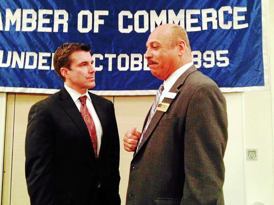 ESPN anchor Rece Davis, left, speaks with Liberty Bank President Chandler Howard at the Middlesex County Chamber of Commerce breakfast meeting Monday in Cromwell. Photo: Michael T. Lyle Jr. — The Middletown Press
