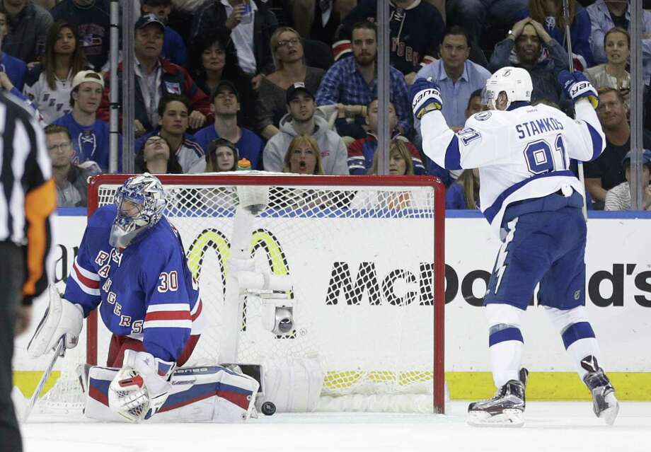 Lightning center Steven Stamkos (91) reacts after scoring against Rangers goalie Henrik Lundqvist in the second period on Sunday. Photo: Frank Franklin — The Associated Press  / AP