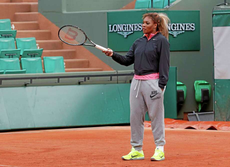 Serena Williams of the U.S., gestures with her racket during a training session for the French Open tennis tournament, at the Roland Garros stadium in Paris, Saturday, May 24, 2014. The French Open tennis tournament starts Sunday. (AP Photo/Michel Euler) Photo: AP / AP