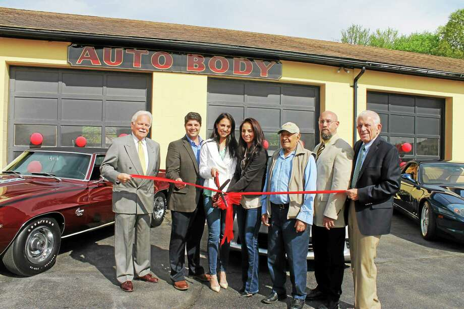 Santostefano Auto Body Collision & Paint Specialists is at 105 Saybrook Road. Shown at the reopening ceremony is, from left, Middletown Small Business Development Center Counselor Paul Dodge, Middletown Mayor Dan Drew, Sabrina and Adrianna Indomenico of Santostefano Auto Body, Sebastian Santostefano, Central Business Bureau Chairman Phil Ouellette, and Chamber President Larry McHugh. Photo: Courtesy Photo