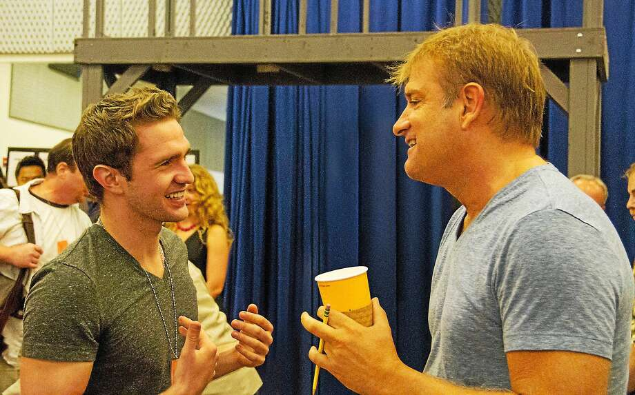 Photo courtesy of the Palace Theater Newsys cast member Dan DeLuca as Jack Kelly, left, talks with director Jeff Calhoun during a recent rehearsal at the Palace Theater in Waterbury. Photo: Journal Register Co.