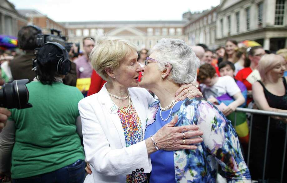 Irish Senator Katherine Zappone, right, and partner Ann Louise Gilligan celebrate as the first results in the Irish referendum start to filter through at Dublin Castle, Ireland on May 23, 2015. Ireland has voted resoundingly to legalize gay marriage in the world's first national vote on the issue, leaders on both sides of the Irish referendum declared Saturday even as official ballot counting continued. Photo: AP Photo/Peter Morrison  / AP