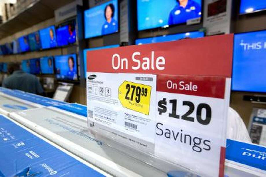 TV sets, are on sale in the Pembroke Pines, Fla. Best Buy store. As stores clear out older merchandise and new models get introduced, good deals abound if you want a big new TV for the Super Bowl or video games.