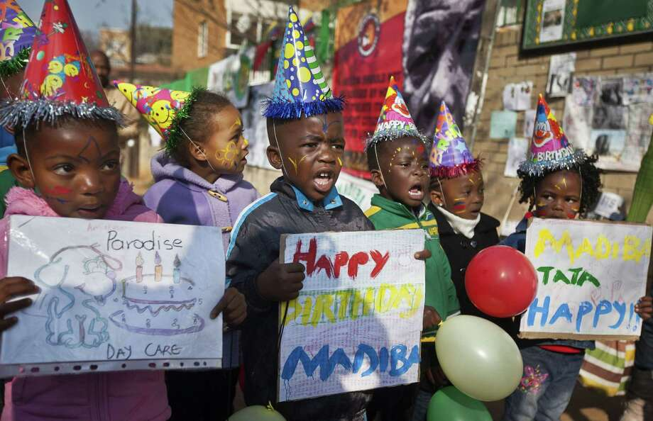"""This July 18, 2013 photo shows a group of kindergarten children singing Happy Birthday to Nelson Mandela outside the Mediclinic Heart Hospital in Pretoria, South Africa. The music publishing company that has been collecting royalties on the song """"Happy Birthday To You"""" for years does not hold a valid copyright on the lyrics to the tune that is one of the mostly widely sung in the world, a federal judge ruled on Sept. 22, 2015. Photo: AP Photo/Ben Curtis, File  / AP"""