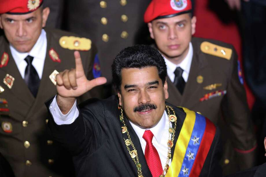 Venezuela's President Nicolas Maduro gestures to supporters upon his arrival for his annual state-of-the-nation address to National Assembly in Caracas, Venezuela, Wednesday. President Maduro acknowledged the economic crisis wracking Venezuela during his address, but did not announce the reforms many had expected. Photo: AP Photo  / AP