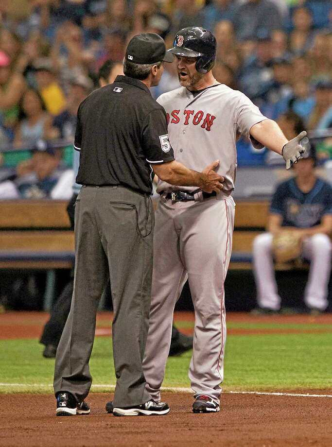 Red Sox catcher David Ross, right, argues a close play with umpire Angel Hernandez Saturday. Photo: Steve Nesius — The Associated Press  / FR69810 AP