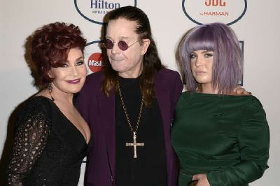 From left, Sharon Osbourne, Ozzy Osbourne and Kelly Osbourne arrive at the 56th annual GRAMMY awards - salute to industry icons with Clive Davis, on Saturday, Jan. 25, 2014, in Beverly Hills, Calif.
