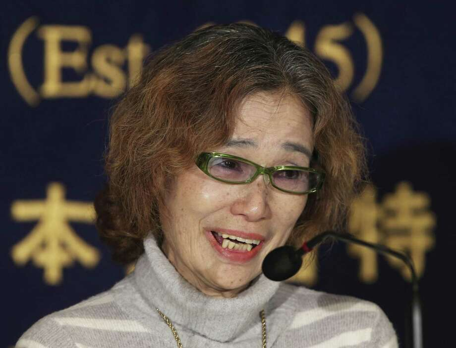 """Junko Ishido, the mother of Japanese journalist Kenji Goto, 47, who was taken hostage by the Islamic State group, speaks during a press conference in Tokyo Friday, Jan. 23, 2015. Militants affiliated with the Islamic State group have posted an online warning that the ìcountdown has begunî for the group to kill the pair of Japanese hostages. """"Time is running out. Please, Japanese government, save my sonís life,"""" said Ishido. """"My son is not an enemy of the Islamic State,"""" she said in a tearful appearance in Tokyo. (AP Photo/Koji Sasahara) Photo: AP / AP"""