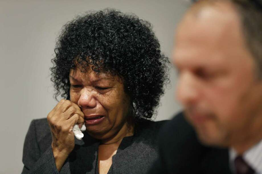 """FILE - In this Sept. 10, 2014, file photo, Beverly Ann Griffin, the mother of Bradley Ballard who died in 2013 at the Rikers Island jail, cries as her lawyer, Jonathan Abady, speaks during a news conference in New York. Federal prosecutors should launch a civil rights probe into the death of mentally ill Rikers Island inmate, Ballard, who was locked in his cell for six days without care or medication, a state oversight panel concluded in a review that called the treatment """"so incompetent and inadequate as to shock the conscience."""" (AP Photo/Seth Wenig, File) Photo: AP / AP"""