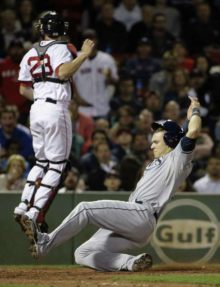 The Tampa Bay Rays' Richie Shaffer, right, scores on a sacrifice fly by Evan Longoria as Red Sox catcher Blake Swihart leaps for the ball during Tuesday's game in Boston. Photo: Steven Senne — The Associated Press  / AP