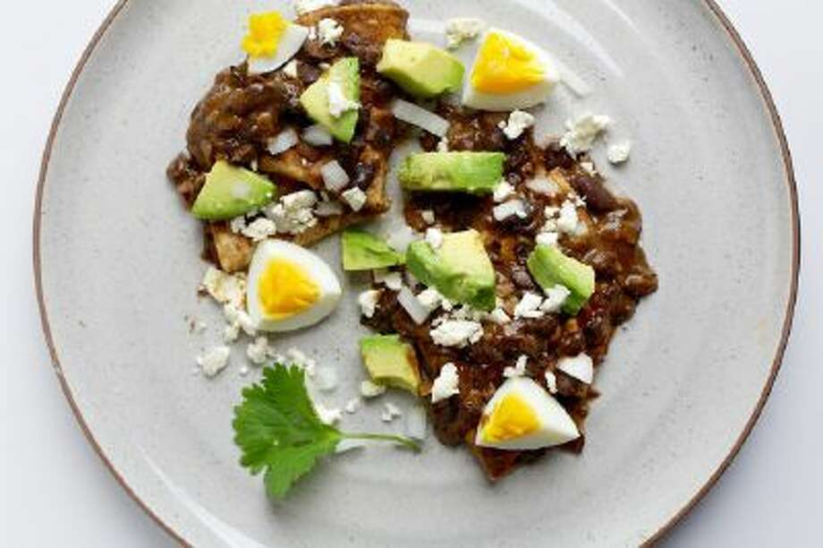 A Mexican tribute to beans: Enfrijoladas With Egg, Avocado and Onion.