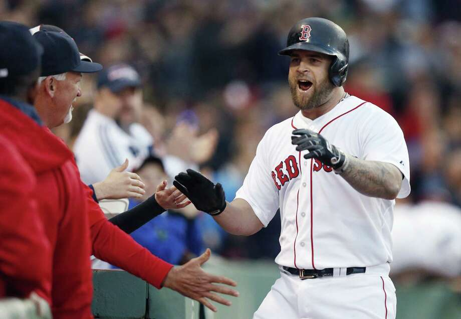 The Red Sox's Mike Napoli, right, celebrates his solo home run during the second inning of Saturday's game against the Los Angeles Angels. Napoli added a two-run homer in the sixth to fuel Boston's 8-3 win. Photo: Michael Dwyer  — The Associated Press  / AP