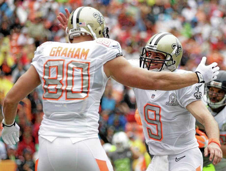 Eugene Tanner — The Associated Press Saints tight end Jimmy Graham is congratulated by Saints quarterback Drew Brees of Team Rice after catching a touchdown in the second quarter of the Pro Bowl Sunday in Honolulu. Photo: AP / FR168001 AP
