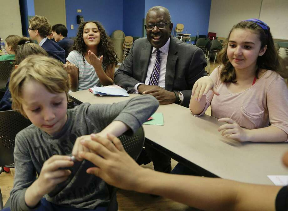 Kevin Washington, center, president and CEO of the YMCA of the USA, participates in a math game being played by young teens at the McBurney YMCA during an open after-school program called The Zone in New York. Photo: Julie Jacobson — The Associated Press  / AP