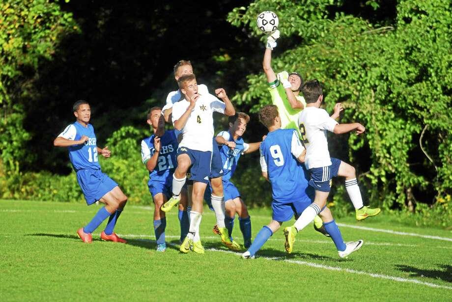 Coginchaug junior keeper Dan Gavrilovic knocks away a corner kick in the Blue Devils' 2-1 win Tuesday at H-K. Photo: Jimmy Zanor — Middletown Press