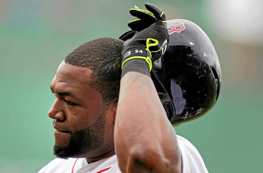 Red Sox designated hitter David Ortiz takes off his batting helmet after grounding out against the Toronto Blue Jays to end the fifth inning of Thursday's game at Fenway Park in Boston. Photo: Charles Krupa — The Associated Press  / AP