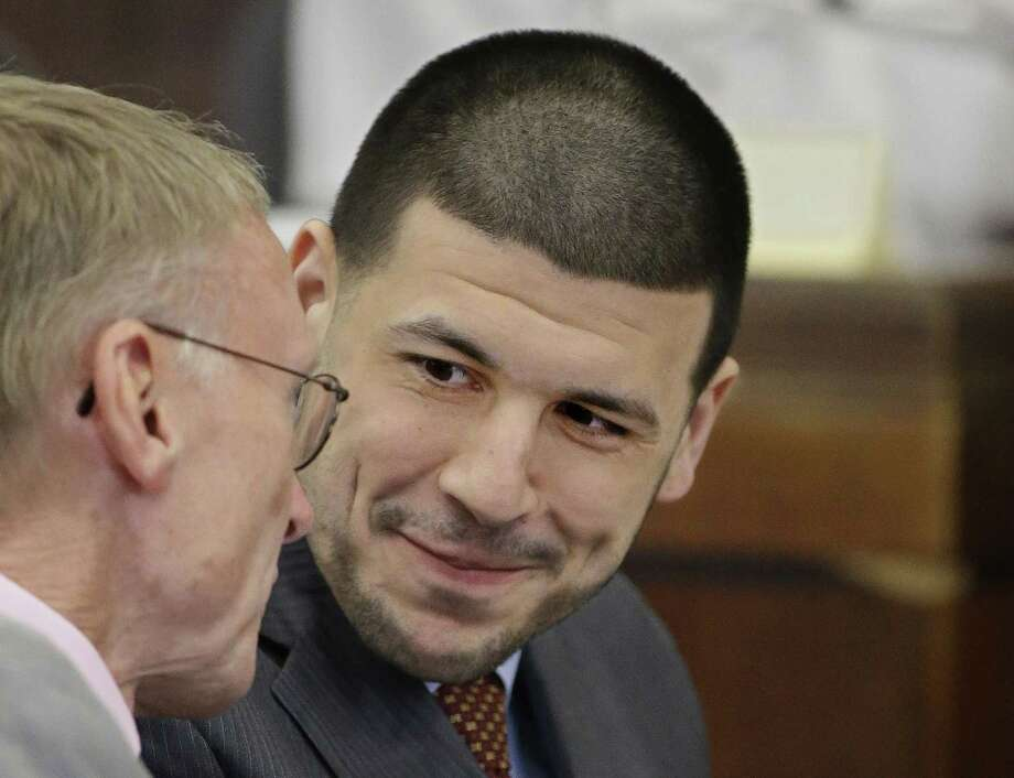 Aaron Hernandez talks with one of his attorneys, Charles Rankin, during his arraignment Thursday at Suffolk Superior Court in Boston. Photo: Stephan Savoia — The Associated Press  / Pool AP