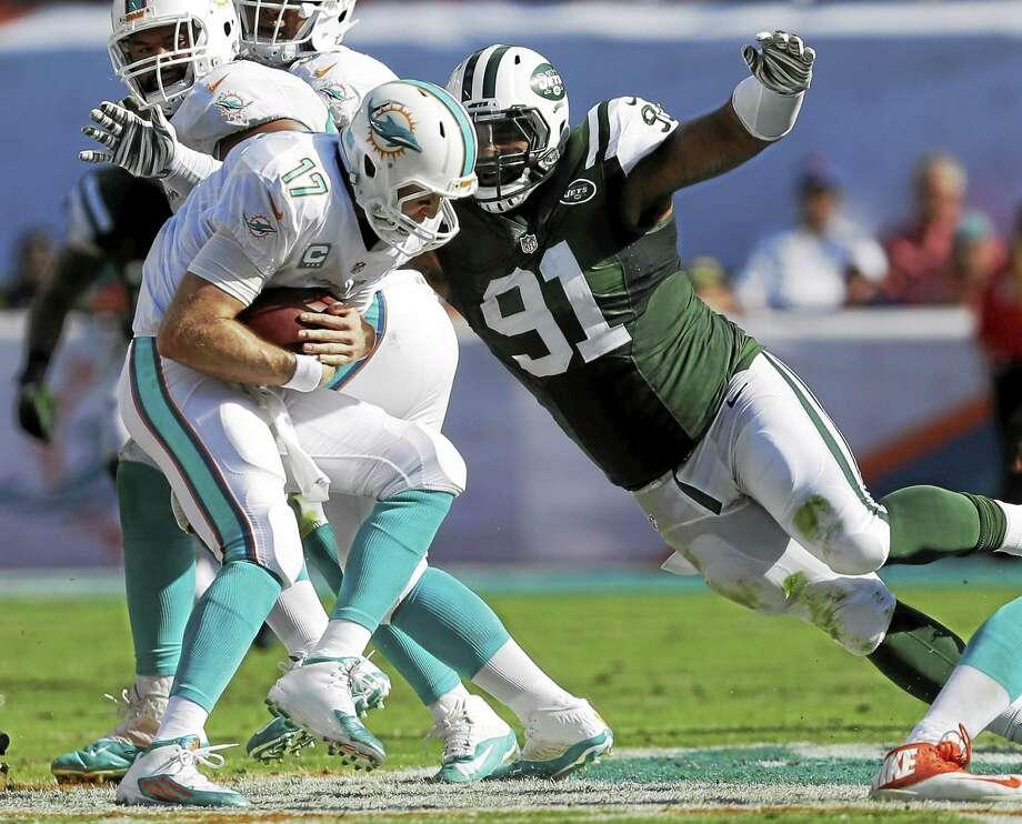 New York Jets defensive end Sheldon Richardson (91) sacks Dolphins quarterback Ryan Tannehill during a Dec. 28, 2014 game in Miami Gardens, Fla. Photo: Wilfredo Lee — The Associated Press File Photo  / AP