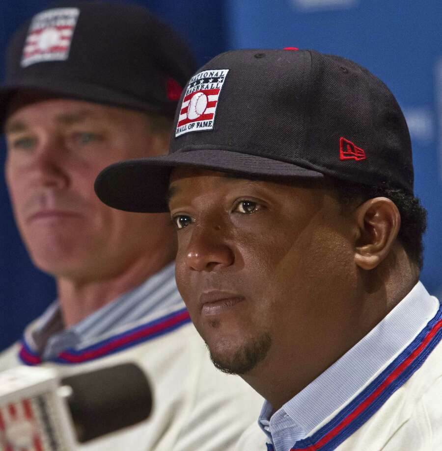 National Baseball Hall of Fame inductee Pedro Martinez, right, will be wearing a Boston Red Sox cap on his plaque in Coopertown. Photo: Bebeto Matthews — The Associated Press File Photo  / AP
