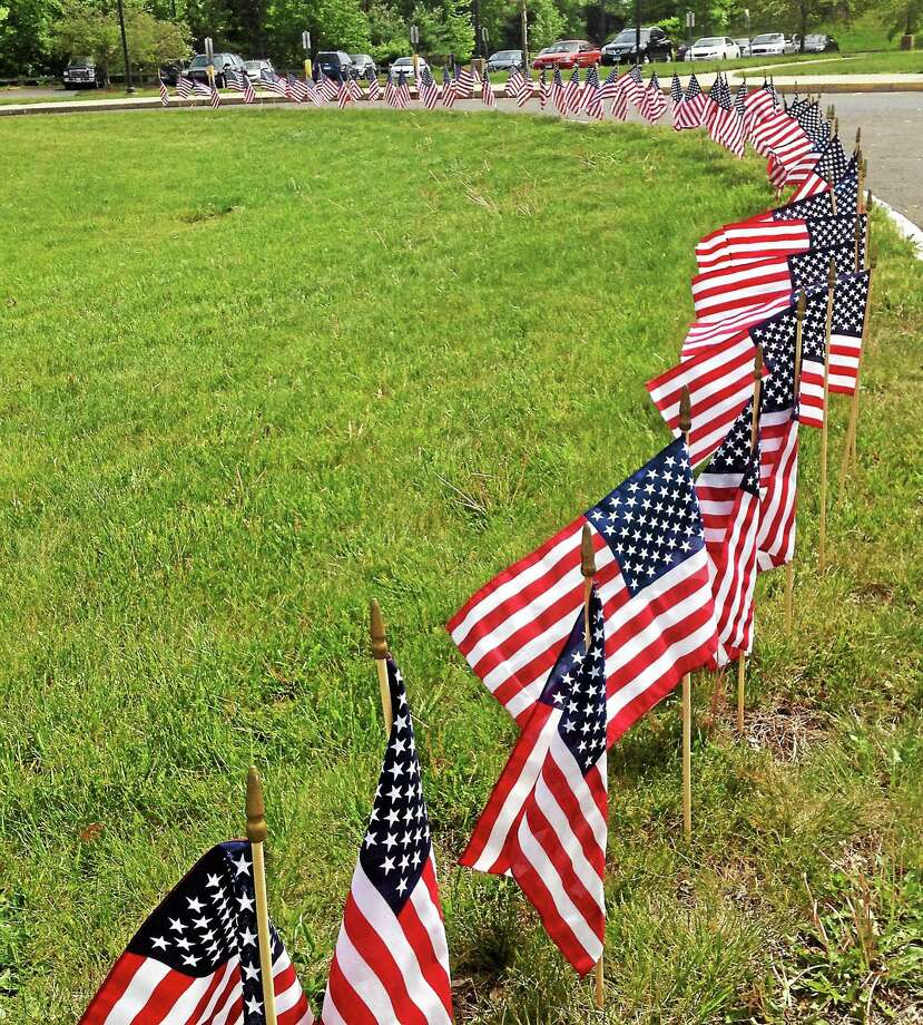 Portland's Memorial Day celebration begins with a breakfast Saturday at the Legion Post and concludes with parade and a wreath-laying ceremony. Photo: Jeff Mill — The Middletown Press