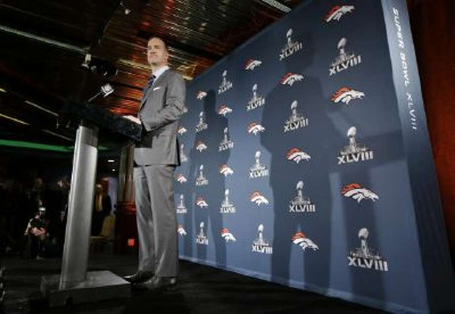 Denver Broncos quarterback Peyton Manning talks with reporters during a news conference Sunday in Jersey City, N.J. The Broncos are scheduled to play the Seattle Seahawks in Super Bowl XLVIII Feb. 2, in East Rutherford, N.J.