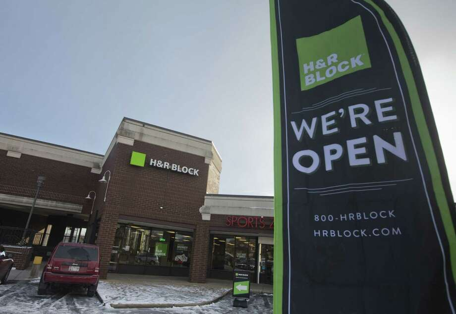 In this Jan. 8, 2015 photo, an ad banner appears on display in the parking lot of the H&R Block offices in the Atlas District in Washington. Photo: AP Photo/Pablo Martinez Monsivais  / AP