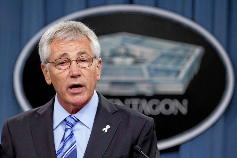 """FILE - In this May 1, 2014 file photo, Defense Secretary Chuck Hagel speaks to reporters at the Pentagon.  Hagel said in an interview broadcast Friday that the focus of an investigation into alleged delayed treatments and deaths in the Veterans Administration's health care system should be to """"fix the problem"""" rather than fire VA Secretary Eric Shinseki.   (AP Photo/Manuel Balce Ceneta) Photo: AP / AP"""